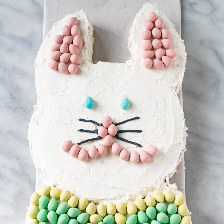 Easter Bunny Cake with Mini Egg ears, nose, and bow tie.