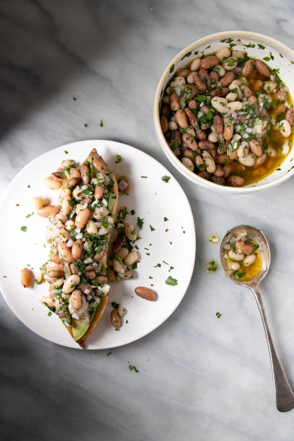 Marinated Beans on a baguettes with avocado.