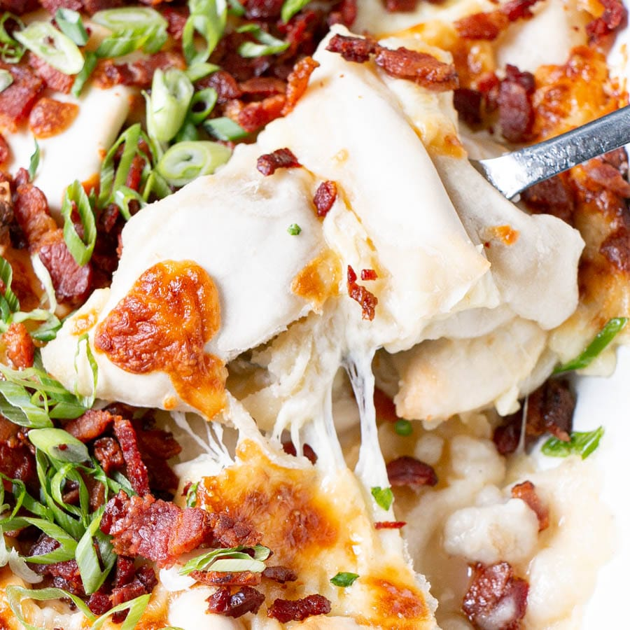 Cheesy Pierogies Casserole with cheese stretched between pierogies